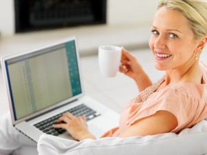 photodune-205019-pretty-mature-woman-having-a-cup-of-coffee-and-using-a-laptop-s1